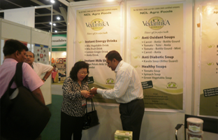 Mr Limbasiya showing products to buyer at Exhibition  at Kuala Lumpur (Malaysia)